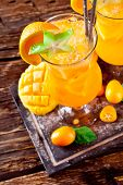 Orange summer coktails with exotic fruit, shot from upper view