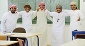 stock photo of kuwait  - Gulf Arabic Muslim people posing - JPG
