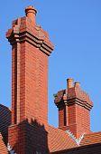 Tall red brick chimneys, England, UK.