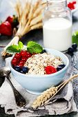 Healthy Breakfast.Oat flake, berries and fresh milk. Health and diet concept