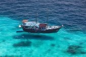 Aerial View Of The Tropical Island, Clear Blue Sea And A Tourist Boat At Tropical Sea, Similan, Thai