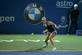 KUALA LUMPUR - APRIL 20, 2014: Donna Vekic of Croatia hits a return in the Singles final of the BMW