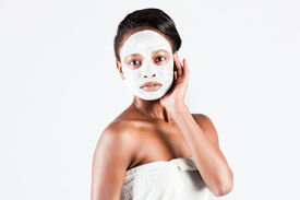 pic of mud pack  - Young African woman in Studio doing body care with refreshing facial mask for young and beautiful skin and relaxation - JPG