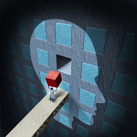 stock photo of cognitive  - Psychology therapy concept with a doctor holding a red block to repair a compartmentalized human brain as a mental health symbol for psychiatry and neurology treatment by a surgeon or research scientist - JPG