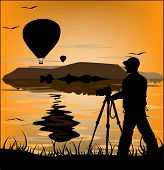 Photographer Silhouette At Sunset And Flying Balloons