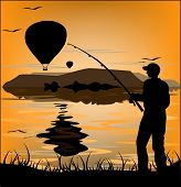 Silhouette Of Fisherman At Sunset And Flying Balloons