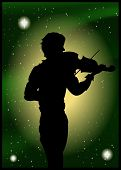 Silhouette Of Violinist On The Background Of The Beautiful Starry Sky