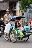 Cyclo driver and his passenger/customer