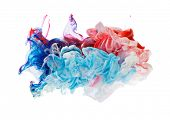 foto of pigment  - Studio shot of colored ink in water - JPG