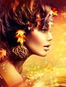 Autumn Woman Fantasy Fashion Golden Portrait. Fall. Beautiful Girl. Fashion Art Border Design. Hairstyle decorated with Autumn leaves.