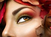 Autumn make up for brown eyes. Closeup fashion makeup. Perfect face skin, autumn warm colors of eyeshadows, long eyelashes.