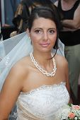 Young brunette bride posing for the camera