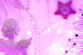 Christmas Background Of Bokeh Lights With An Angel And A Star