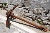 Old rusty ship anchor in Greek street