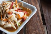 Papaya Salad With The Wood Background. Papaya Salad Is A Famous Thai Traditional Food.