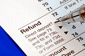stock photo of cpa  - Getting refund from the income tax return isolated on blue - JPG