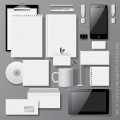 Vector set of white design corporate identity templates with notepad, envelope, business card, CD, Mobile phone, Tablet computer, flag, badge, mug  and other office accessories