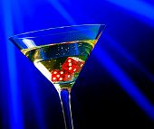 Red Dice In The Cocktail Glass On Blue Light Casino Concept