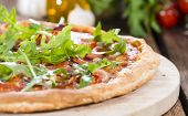 Ham Pizza With Rocket And Fresh Tomatoes