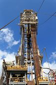 image of derrick  - Derrick of Tender Drilling Oil Rig  - JPG