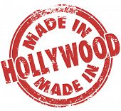 Made in Hollywood words in a round red stamp to show pride in products like entertainment and movies from California state