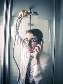 Businessman in the shower