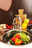 Fresh vegetables in sink in kitchen