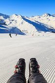image of ski boots  - Closeup photo of ski boots on snowy background - JPG