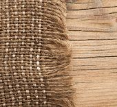 Burlap texture on wooden table background