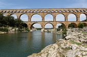 picture of aqueduct  - Pont du Gard is an old Roman aqueduct near Nimes in Southern France - JPG