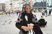 A very old Turkish woman selling birdseeds at Taksim Sqaure