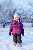 Adorable little girl outdoors on cold winter day