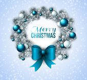Christmas wreath with blue and white baubles.