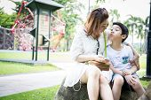 Beautiful Asian Woman With Your Son