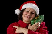 Smiling Female Senior With Red Santa Claus Cap.