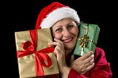 Old Woman In Red With Two Wrapped Christmas Gifts.