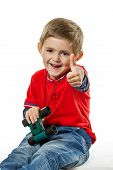 Portrait Of A Seated Boy With Thumb Up