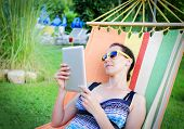 In Hammock With Tablet Pc