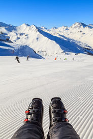 pic of ski boots  - Closeup photo of ski boots on snowy background - JPG