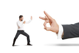 stock photo of male-domination  - concept photo of conflict between subordinate and boss - JPG