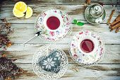 Vintage cups of herbal tea with heart shape