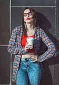 Young Beautiful Hipster Girl In Red Blouse With Cup Of Coffee