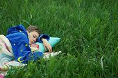 girl sleeping in the grass