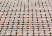 picture of paving stone  - Octagonal paving stones pattern in perspective with gravel and grass in spaces.