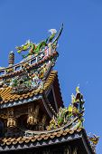 Colorful wooden carvings on roof of Japanese temple