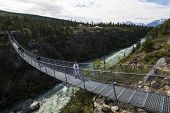 Tourist on Yukon Suspension Bridge