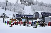 Skiers and snowboarders in Rosa Khutor Alpine Resort