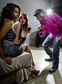 stock photo of soliciting  - pickup artists harrassing women at a nightclub - JPG