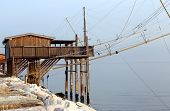 Large Stilt House Near The Sea And Fishing Nets