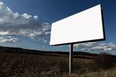 foto of oblong  - Big oblong white blank advertising billboard and clouds in sky - JPG